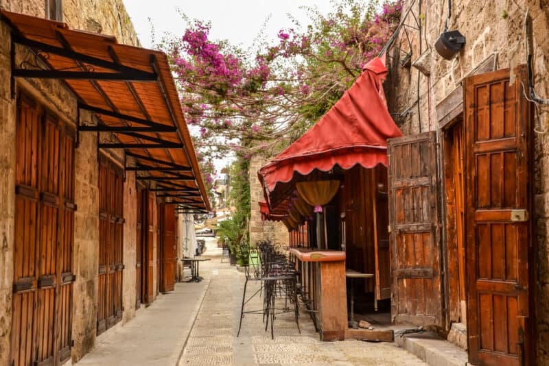 Beautiful street with red canopies and wooden shutters in Byblos Lebanon